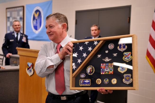 U.S. Air Force Col. Kelvin G. Findlay displays a shadowbox given to him at his retirement ceremony at the Utah Air National Guard Base, Salt Lake City, Utah, January 7, 2012. Findlay served for 32 years in the Utah Air National Guard before retiring from military service. (U.S. Air Force Photo by TSgt Jeremy Giacoletto-Stegall/Released)