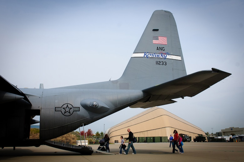 Family members of Airmen assigned to the 123rd Airlift Wing board a C-130 Hercules on display Oct. 23, 2011, during the unit's annual Family Day in Louisville, Ky. The event is held to celebrate and thank the families of Airmen who serve in the Kentucky Air National Guard. (U.S. Air Force photo by Senior Airman Maxwell Rechel)