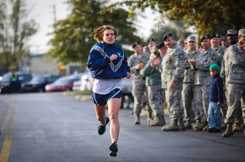 Senior Airman Brandy Craig, a fire team member from the 123rd Security Forces Squadron, competes in the Base Fitness Challenge held Oct. 23, 2011, at the Kentucky Air National Guard Base in Louisville, Ky. More than 60 Airmen from the 123rd Airlift Wing participated in the third-annual event, which featured a relay race, sit-ups and push-ups. (U.S. Air Force photo by Master Sgt. Phil Speck)