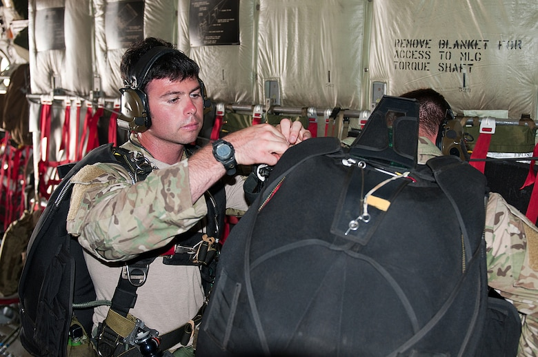 Staff Sgt. George Reed, an Air Force active-duty pararescueman from the 38th Rescue Squadron at Moody Air Force Base, Ga., checks his fellow pararescueman's parachute gear June 14, 2011, before they parachute into Camp Atterbury, Ind., during a Precision Jumpmaster Course. The training, conducted by members of the 123rd Special Tactics Squadron, was made possible in part because of the squadron's access to C-130 airlift provided by the 123rd Airlift Wing, the main operational unit of the Kentucky Air Guard. (U.S. Air Force photo by Master Sgt. Phil Speck)