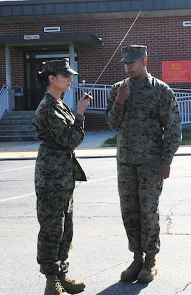 Then-Staff Sgt. Morgon Latimore, OSJA, instructs Cpl. JoAnna Sudduth on sword     manual in the rear parking lot of Building 3500, Jan. 27.