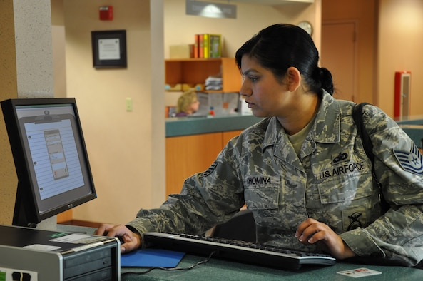 Tech. Sgt. Cristina Chomina, 9th Security Forces Squadron, uses a computer at the Administrative Support Flight at Beale Air Force Base, Calif., Jan. 5, 2012. The ASF utilizes computers to reduce customer wait time and improve customer service. (U.S. Air Force photo by Staff Sgt. Robert M. Trujillo)