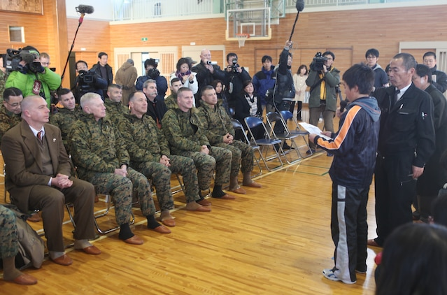 Col. Andrew R. MacMannis, commanding officer, 31st Marine Expeditionary Unit (seated, second from right), sits with other Marine Corps senior leaders as a child of the Oshima Island community speaks about his experiences Jan. 12.  The children expressed their gratefulness for the disaster relief efforts of the 31st MEU. The official visit to Oshima Island and Kesennuma City, Miyagi Prefecture was to review community recovery progress since Operation Tomodachi and to discuss potential humanitarian assistance and disaster relief capabilities to better prepare for future support requirements. During the visit, members of the 31st MEU were able to revisit areas where they provided disaster relief assistance during recovery efforts ten months earlier.  Senior leaders with the group include Lt. Gen. Kenneth J. Glueck, commanding general, III Marine Expeditionary Force and Maj. Gen. Peter J. Talleri, commanding general, Marine Corps Installations Pacific. The 31st MEU is the only continually forward deployed MEU, and remains America's force in readiness in the Asia-Pacific region.