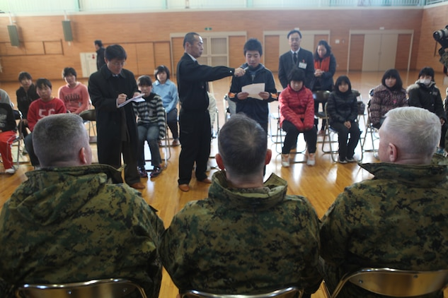 Col. Andrew R. MacMannis, commanding officer, 31st Marine Expeditionary Unit (seated, left), sits with other Marine Corps senior leaders as a child of the Oshima Island community speaks about his experiences Jan. 12.  The children expressed their gratefulness for the disaster relief efforts of the 31st MEU. The official visit to Oshima Island and Kesennuma City, Miyagi Prefecture was to review community recovery progress since Operation Tomodachi and to discuss potential humanitarian assistance and disaster relief capabilities to better prepare for future support requirements. During the visit, members of the 31st MEU were able to revisit areas where they provided disaster relief assistance during recovery efforts ten months earlier.  Senior leaders with the group include Lt. Gen. Kenneth J. Glueck, commanding general, III Marine Expeditionary Force and Maj. Gen. Peter J. Talleri, commanding general, Marine Corps Installations Pacific. The 31st MEU is the only continually forward deployed MEU, and remains America's force in readiness in the Asia-Pacific region.