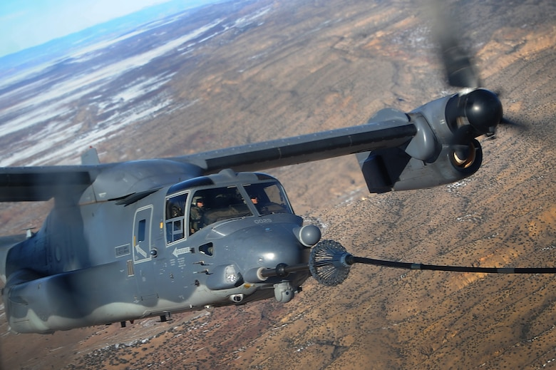 A 71st Special Operations Squadron CV-22 Osprey receives fuel from a 522 SOS, MC-130J Commando II aircraft, over the skies of New Mexico, Jan. 4, 2012.  The 71 SOS is stationed at Kirtland Air Force Base, N.M., and conducted air refueling training with the 522 SOS, stationed at Cannon AFB, N.M.  (U.S. Air Force photo by Airman 1st class Xavier Lockley)