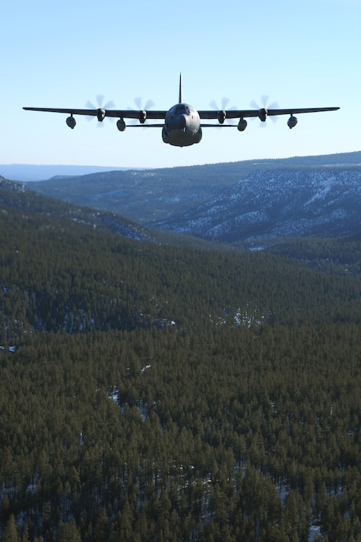 A 522nd Special Operations Squadron MC-130J Commando II aircraft, flies over the skies of New Mexico, Jan. 4, 2012.  The 522 SOS is stationed at Cannon Air Force Base, N.M. and the MC-130J provides in-flight refueling, infiltration/exfiltration and aerial delivery resupply of special operations forces.  (U.S. Air Force photo by Senior Airman James Bell)