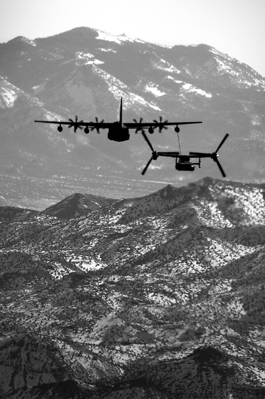 A 71st Special Operations Squadron, CV-22 Osprey, is refueled by a 522 SOS Squadron MC-130J Commando II over the skies of New Mexico, Jan. 4, 2012.  The 71 SOS is stationed at Kirtland Air Force Base, N.M., and the 522 SOS at Cannon AFB, N.M.  The MC-130J provided in-flight refueling as part of a joint-base partnership.  (U.S. Air Force photo by Senior Airman James Bell)