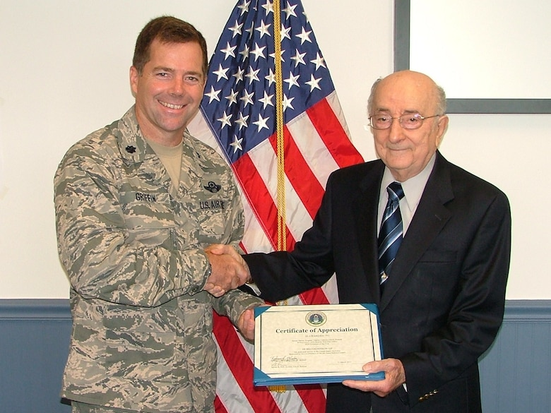 Retired Senior Master Sgt. Vincent Celenza was selected as the Air Force Retiree Activities Volunteer of the Year award on Jun. 18, 2011. Presenting the award was