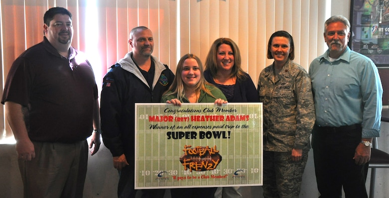 (Left to Right) Andy Pauley, 9th Force Support Squadron Community Services flight chief, Maj. (Ret.) Kerry Adams, Taryn Adams, Heather Adams, Maj. Connie May, 9th FSS commander, and Ray Woodbeck, 9th FSS Recce Point Club manager. Heather Adams recently won an all expenses paid trip to the 2012 Super Bowl in Indianapolis as part of the Air Force Club's Football Frenzy promotion. Adams is the second consecutive Super Bowl winner from Beale. (U.S. Air Force photo by Senior Airman Chuck Broadway/Released)