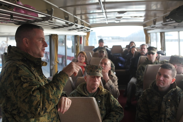 Col. Andrew R. MacMannis, commanding officer, 31st Marine Expeditionary Unit (standing), briefs Marine Corps senior leaders and members of the Oshima Island community on 31st MEU disaster relief efforts conducted in Operation Tomodachi during an official visit Jan. 13. The official visit to Oshima Island, Kesennuma City, Miyagi Prefecture was to review community recovery progress since Operation Tomodachi and to discuss potential humanitarian assistance and disaster relief capabilities to better prepare for future support requirements. During the visit, members of the 31st MEU were able to revisit areas where they provided disaster relief assistance during recovery efforts ten months earlier.  Senior leaders with the group include Lt. Gen. Kenneth J. Glueck, commanding general, III Marine Expeditionary Force and Maj. Gen. Peter J. Talleri, commanding general, Marine Corps Installations Pacific. The 31st MEU is the only continually forward deployed MEU, and remains America's force in readiness in the Asia-Pacific region.