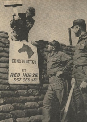 THIS ONE'S OURS --Joining military personnel and Korean nationals at Osan AB, Red Horse personnel assisted in building sand bag bunkers in scattered areas of the base. Each Red Horse bunker has a sign such as the one displayed by, from left to right, MSgt. John E. Hopkins, MSgt. William M. Castor and 1st Lt. James E. Hoskins.