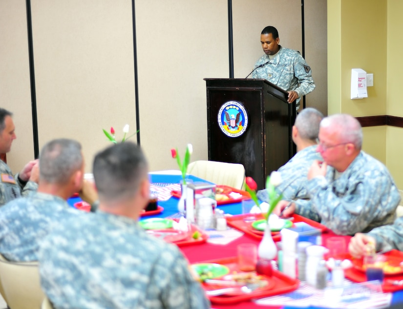 SOTO CANO AB, Honduras ? Major Adrian Henderson, Joint Task Bravo ? Force staff judge advocate, gives the key note speech during the Dr. Martin Luther King, Jr. luncheon Jan. 12 at the dining facility in front of more than 50 servicemembers. The Dr. Martin Luther King, Jr., holiday was established in 1983 and was set to be on the third Monday of January to celebrate the civil-rights leader?s birthday Jan. 15. (Air Force photo/Staff Sgt. Bryan Franks)