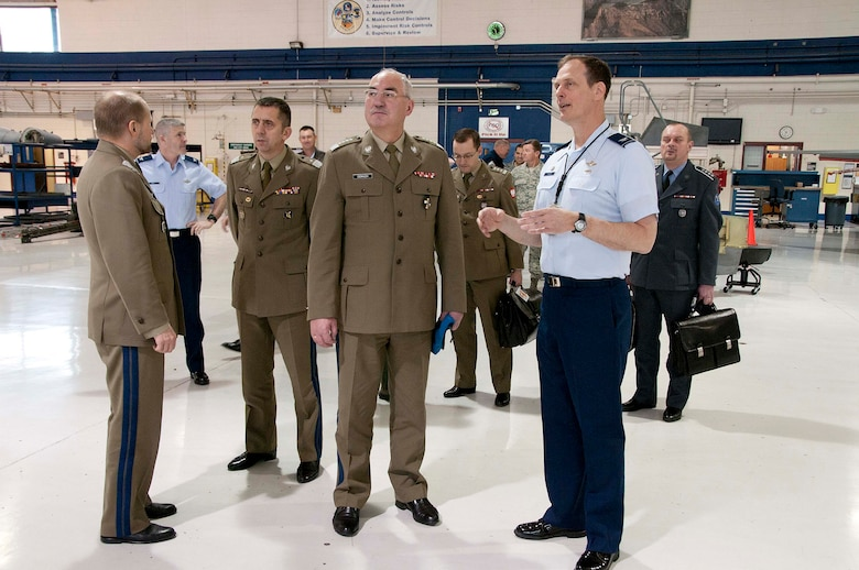 Polish Army Gen. Mieczyslaw Cieniuch (center), Chief of the General Staff of the Polish Armed Forces, is escorted on a tour of 162nd Fighter Wing aircraft maintenance facilities by Col. Jim Taylor, 162nd Maintenance Group commander. (U.S. Air Force photo/Master Sgt. Dave Neve)