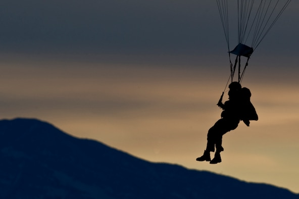 A U.S. Air Force pararescueman, 58th Rescue Squadron, perpares to land during a military freefall jump Jan. 11, 2012, at Wendover Field, Utah. Pararescuemen are trained to provide emergency medical treatment in adverse terrain and conditions in combat or peacetime. (U.S. Air Force photo by Airman 1st Class Daniel Hughes/Released)