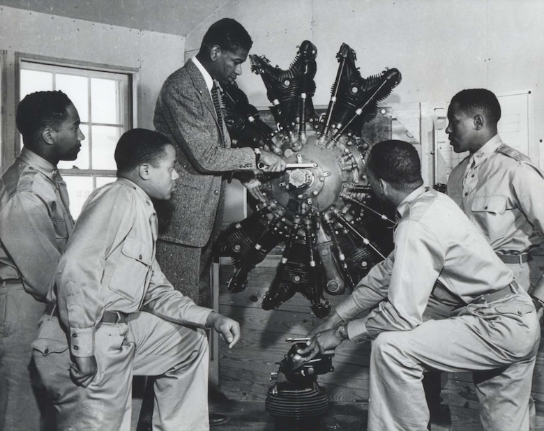 Cadets in ground school study a radial aircraft engine, 1942.