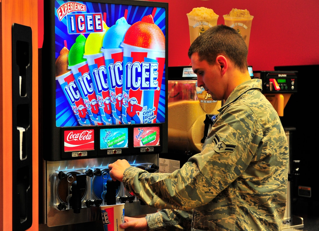 U.S. Air Force Airman 1st Class Josh Wagner, 20th Comptroller Squadron permanent change of station technician, uses the Icee machine at the recently renovated shoppette at Shaw Air Force Base, S.C. Jan. 17, 2011. Approximately $400,000 of renovations were completed to accomodate the growing population of Shaw, resulting in faster service and a greater capacity for goods.  (U.S. Air Force photo/Senior Airman Neil D. Warner/Released)