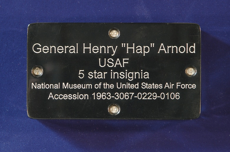 Inscription on the back of the Plexiglas container on display. Museum staff custom-built this container to keep Arnold's insignia well-protected during Endeavour's final flight. (U.S. Air Force photo)