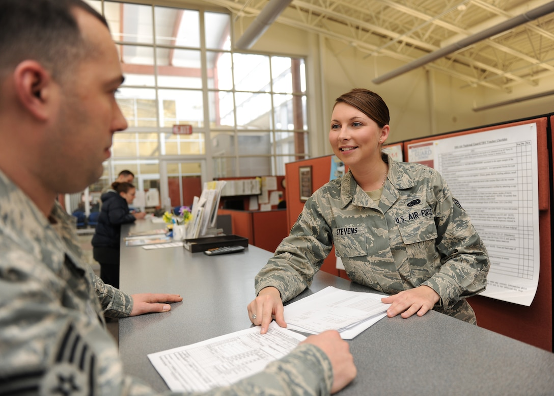 New York Air National Guard Senior Airman Leanne Stevens shows a fellow airman the correct form to fill out at Hancock Field Air National Guard Base in Syracuse NY, on 4 January 2012.  Senior Airman Stevens was selected to represent Hancock Field at the state level in the Outstanding Airman of the Year competition in the Airman category. (photo by Tech. Sgt. Ricky Best/RELEASED)