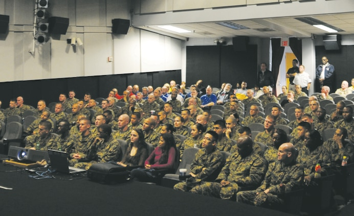 Marines gathered at the Base Theater, Jan. 11, for annual briefs known as 'back in the saddle.' The briefs help prepare the Marines coming off holiday leave for the upcoming year.