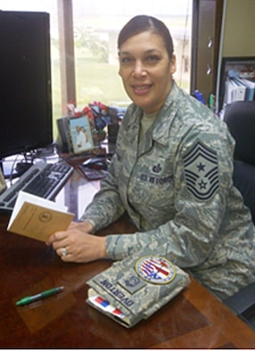 "Command Chief Master Sgt. Margarita Overton sits at her desk asking Airmen, ""whats on your 'not-to-do' list this year?""  (U.S. Air Force photo/Tech. Sgt. Danielle Spencer)"