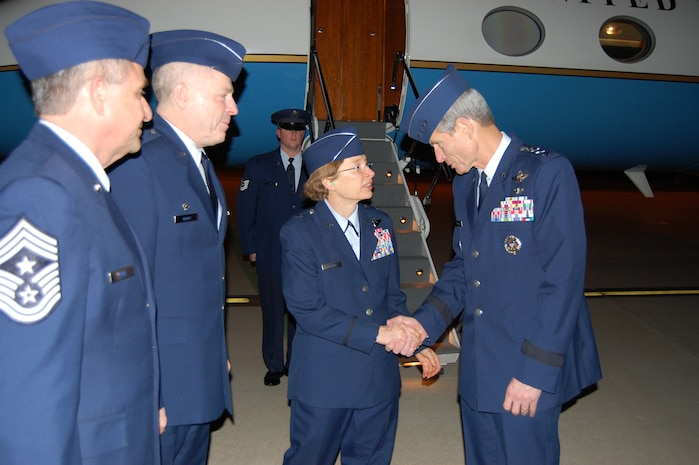 Air Force Chief of Staff Gen. Norton Schwartz receives a unit coin from Brig. Gen. Carol Timmons, Assistant Adjutant General for Air, Delaware National Guard, after she and 166th Airlift Wing Commander Col. Jonathan Groff, Delaware Air National Guard, and 166th AW Command Chief Master Sgt. Henry Rome greet Gen. Schwartz upon his arrival at the New Castle ANG Base, New Castle, Del., the evening of Jan. 19, 2012. (U.S. Air Force photo/Tech. Sgt. Benjamin Matwey)