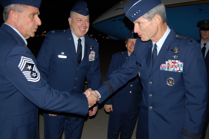 Air Force Chief of Staff Gen. Norton Schwartz exchanges a handshake with 166th Airlift Wing Command Chief Master Sgt. Henry Rome, Delaware Air National Guard, after Gen. Schwartz arrives at the New Castle ANG Base, New Castle, Del., the evening of Jan. 19, 2012. Brig. Gen. Carol Timmons, Assistant Adjutant General for Air, Delaware National Guard, and 166th AW Commander Col. Jonathan Groff, Delaware ANG, also greeted Gen. Schwartz. (U.S. Air Force photo/Tech. Sgt. Benjamin Matwey)