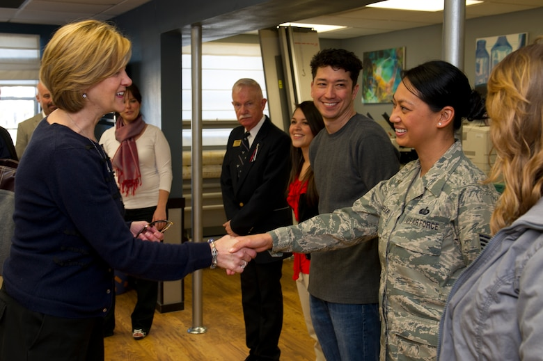 HOLLOMAN AIR FORCE BASE, N.M. -- Kim Rand, wife of U.S. Air Force Lt. Gen. Robin Rand, 12th Air Force commander, shakes hands with Tech. Sgt. Michelle Villaflor, 49th Force Support Squadron marketing assistant, Jan. 19, at the Marketing Office. Rand accompanied her husband on his first trip to Holloman and visited with different base agencies. (U.S. Air Force photo by Senior Airman Kasey Close/Released)