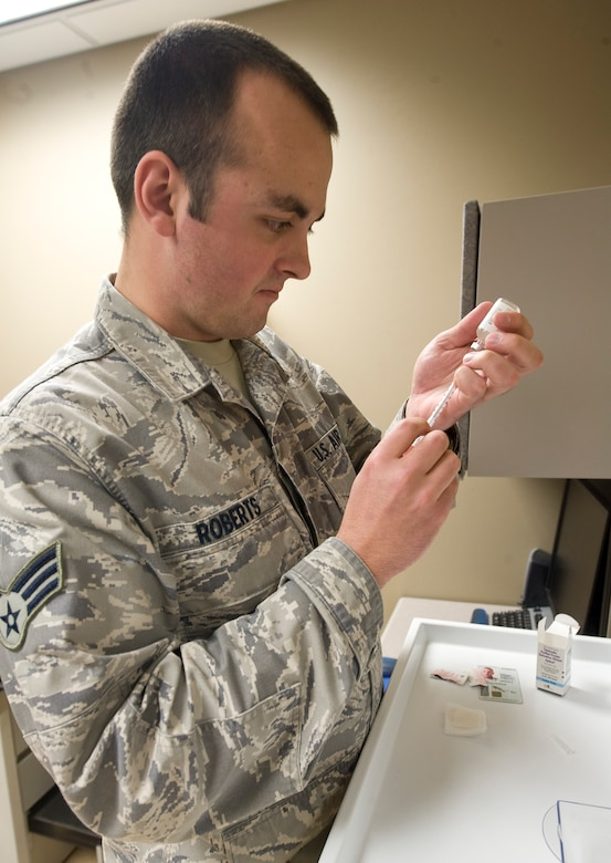 Senior Airman Alexander Roberts, 2nd Medical Group, prepares an injection for a patient in the immunizations clinic on Barksdale Air Force Base, La., Jan. 18. The clinic provides a wide variety of vaccinations, as well as copies of shot records for Barksdale Airmen and their dependents. (U.S. Air Force photo/Senior Airman Chad Warren)(RELEASED)