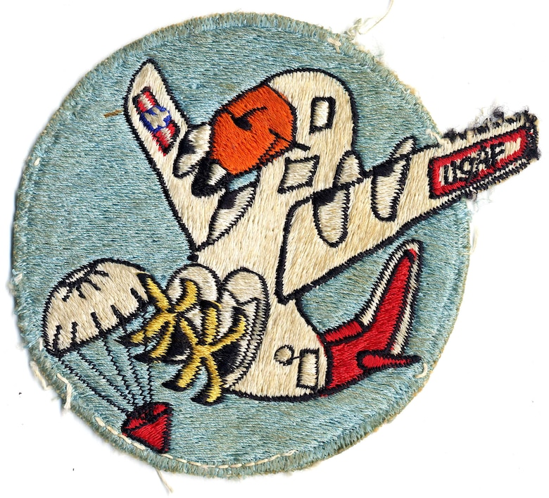 "Informal patch from the USAF 6594th Test Group showing a C-130 ""bird"" catching a satellite payload. (U.S. Air Force photo)"