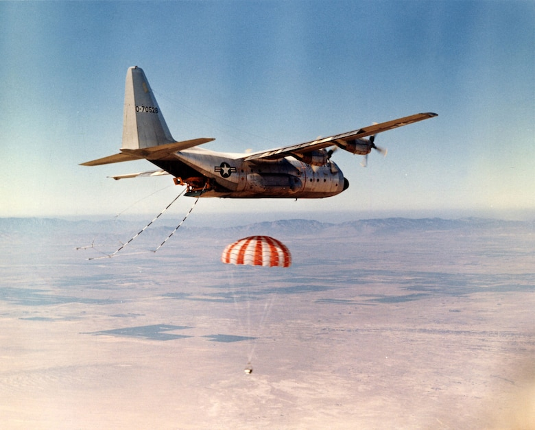 "An Air Force JC-130B practices catching a satellite ""bucket"" with grappling gear and winch at Edwards AFB, Calif., 1969. (U.S. Air Force photo)"