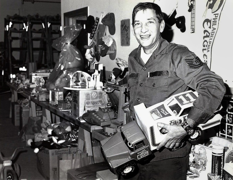 Historical photo of Tech. Sgt. William G. Willey delivering donated toys during one of the 177th Toys for Tots drives. The annual Willey award was created by the 177th Chief's Council to honor his memory by selecting a Senior Non-Commissioned Officer that demonstrated the same qualities Willey exemplified.  (U.S. Air Force photo by Master Sgt. Terry Young, 177th Fighter Interceptor Group Visual Information)