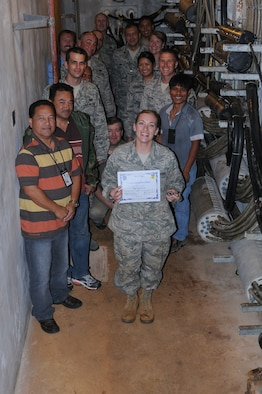 ANDERSEN AIR FORCE BASE, Guam—Staff Sgt. Kylie Herron, 36th Communications Squadron, cable antennamaintenance technician was awarded Team Andersen's Best here, Jan. 12.  Andersen's Best is a recognition program which highlights a top performer from the 36th Wing. Each week, supervisors nominate a member of their team for outstanding performance and the wing commander presents the selected Airman/Civilian with an award. (U.S. Air Force photo by Senior Airman Carlin Leslie/Released)