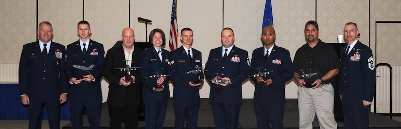 Colonel Erik Hansen (left) and Chief Master Sgt. Larry Williams (right) recognize Staff Sgt. Shawn Goggin, Richard Larkins, Capt. Rebecca Logan, Senior Airman Ronald Sangston, Master Sgt. Christopher Wilson, 1st Lt. Roy Jefferson and Jeremy Olive as the 437th Airlift Wing Quarterly Award winners during a ceremony Jan. 19 at the Charleston Club. Hansen is the 437th AW commander, Williams is the 437th AW command chief, Goggin is from the 14th Airlift Squadron, 437th AW, Larkins is from the 437th Maintenance Squadron, Logan is from the 437th Aircraft Maintenance Squadron, Sangston is from the 437th AMXS, Wilson is  from the 437th Maintenance Operations Squadron, Jefferson is from the 437th Aerial Port Squadron and Olive is from the 437th APS. Not pictured is Tech. Sgt. Michael Morris from the 15th Airlift Squadron, 437th AW. (U.S. Air Force photo/Airman First Class Ashlee Galloway).