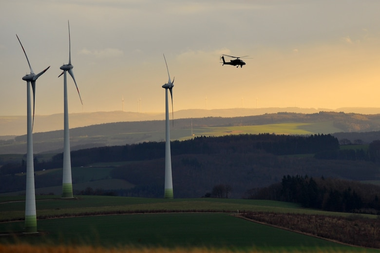 BAUMHOLDER, Germany – A U.S. Army AH-64 Apache flies flight patterns during joint forces combat search and rescue training at the Baumholder Major Training Area here Jan. 23. The training integrates U.S. Army and Air Force resources to more accurately simulate the real-life CSAR and close air support scenarios encountered in deployed locations. The goal of this training is to develop tactics, techniques and procedures between military branches to enhance interoperability. (U.S. Air Force photo/Airman 1st Class Dillon Davis)