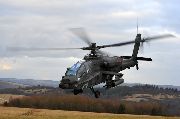 BAUMHOLDER, Germany – A U.S. Army AH-64 Apache takes off during joint forces combat search and rescue training at the Baumholder Major Training Area here Jan. 23. The training integrates U.S. Army and Air Force resources to more accurately simulate the real-life CSAR and close air support scenarios encountered in deployed locations.The goal of this training is to develop tactics, techniques and procedures between military branches to enhance interoperability. (U.S. Air Force photo/Airman 1st Class Dillon Davis)