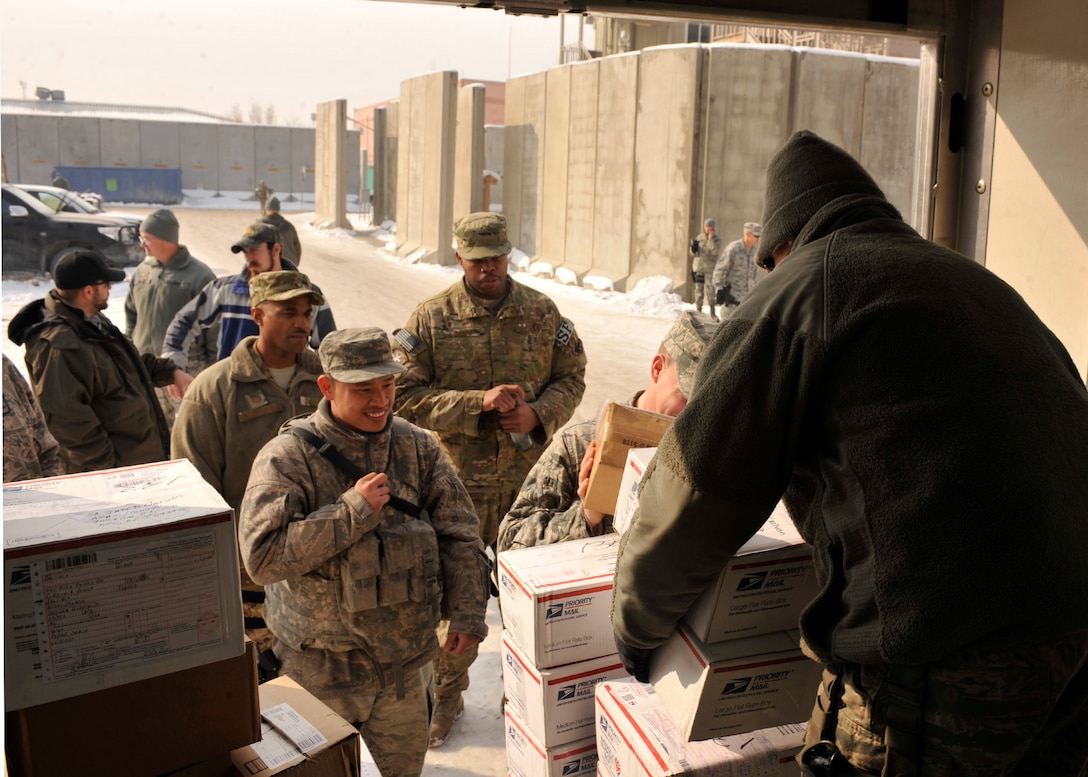 BAGRAM AIRFIELD, Afghanistan— Staff Sgt. Jennifer Albitz distributes mail to members of Security Forces at Bagram Airfield, Afghanistan, Jan. 24, 2012. Albitz is the assistant noncommissioned officer in charge of the Air Force Mail Distribution Center and is deployed from Whiteman Air Force Base, Mo. (U.S. Air Force photo/ Airman 1st Class Ericka Engblom)