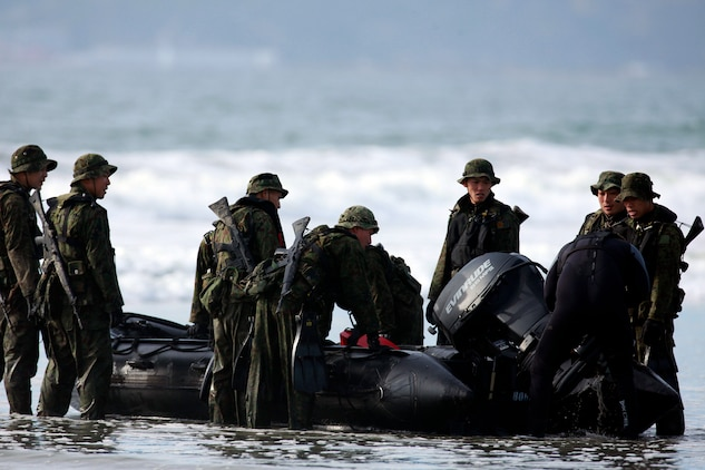Japanese Soldiers with the Western Army Infantry Regiment, Japanese Ground Self Defense Force conduct amphibious training at Naval Amphibious Base Coronado, Jan. 22. The JGSDF are here to participate in Exercise Iron Fist with the 15th Marine Expeditionary Unit, a unique training opportunity for both services. Boats are one of the many amphibious means the Marine Corps uses to move troops ashore in an expeditionary manner. Marine Expeditionary Units are responsible to our nation as a 911 force in readiness.