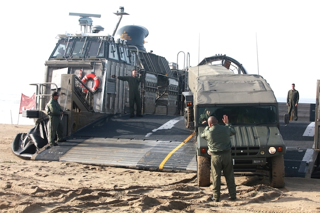 Japanese soldiers drive their tactical vehicles aboard a Landing Craft Air Cushion during a familiarization exercise at Camp Pendleton, Calif., Jan. 24. The event was part of Exercise Iron Fist 2012, a bilateral amphibious training exercise between U.S. Marines and the Japanese Ground Self Defense Force.