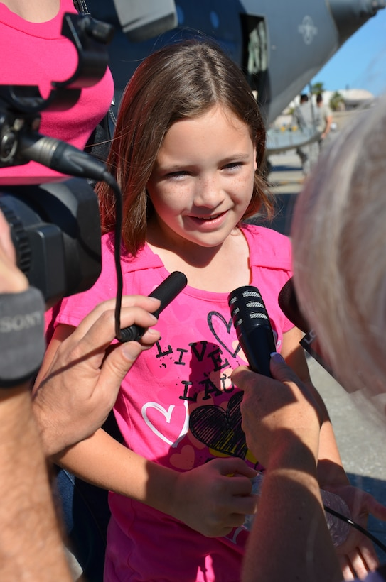 Master Sgt. Joel Lindsey's daughter hams it up for local news stations prior to her father, an electronic integrated systems supervisor for the 920th Rescue Wing, Patrick Air Force Base, Fla., deployed to the Horn of Africa Jan 25. Her father is among the 60 Rescue Reservists who will be deployed from the 920th in support of the ongoing search and rescue and humanitarian relief efforts there. (U.S. Air Force photo/Senior Airman Natasha Dowridge)
