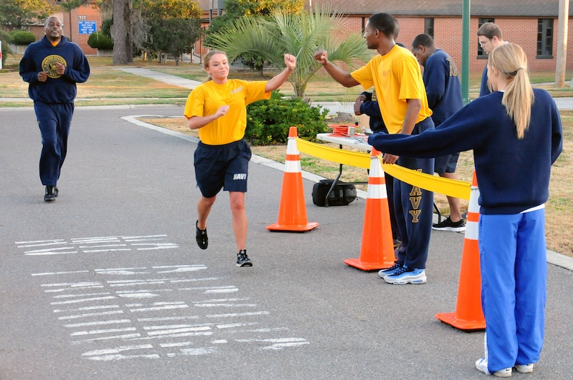 Petty Officer 2nd Class April Butler is cheered on by shipmates as she finishes the Road Rage challenge at Joint Base Charleston - Weapons Station, Jan. 25.  The Road Rage is a five kilometer race sponsored by Morale, Welfare and Recreation in order to promote healthy lifestyles to service members. Butler is a Ship's Serviceman at the JB Charleston – Weapons Station Unaccompanied Personnel Housing office. (U.S. Navy photo/Petty Officer 2nd Class Brannon Deugan)