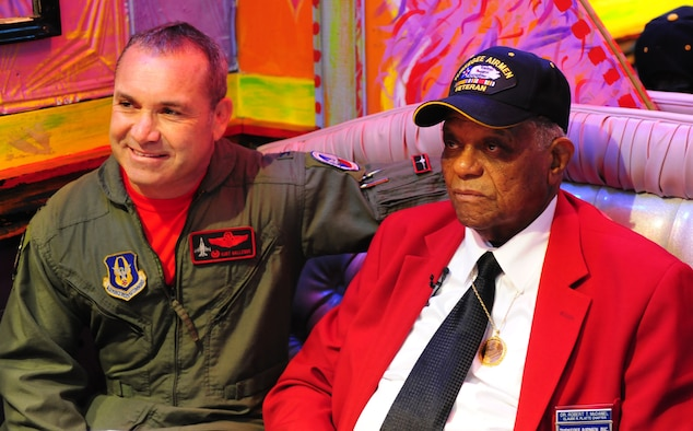 "Tuskegee Airman Dr. Robert T. McDaniel, 88, poses with Col. Kurt Gallegos, 301st Operations Group commander, during a celebration of the opening of ""Red Tails."" The movie is based on the first all-black squadron of bombers, pilots and maintainers in the Armed Forces during World War II. Gallegos has served in three of the four units associated with the Tuskegee Airmen. (U.S. Air Force photo/Senior Airman Martha Whipple)"