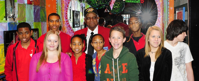 "Tuskegee Airman Dr. Robert T. McDaniel, 88, poses with a group of local youths during a celebration of the opening of ""Red Tails."" The movie is based on the first all-black squadron of bombers, pilots and maintainers in the Armed Forces during World War II. (U.S. Air Force photo/Senior Airman Martha Whipple)"