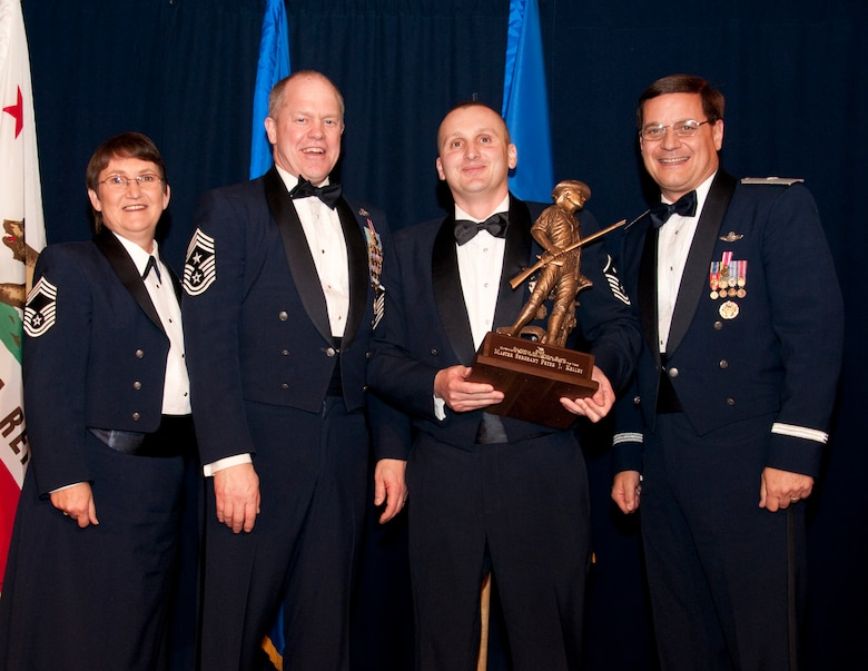 1st Sergeant Ronald Hazelton (center) from the 162rd Combat Communications Group accepts the Outstanding Airman of the Year award in the 1stSgt category. Accompanied by Chief Master Sgt. Debra Fordyce, (far left) Command Chief Master Sgt. Christopher Muncy, (left) and Brigadier General James Witham at the  annual Outstanding Airmen Of The Year Awards Banquet at The Sheraton Universal Hotel, Universal City, Calif.,  January 21, 2012. Each organization nominated four candidates for Airman of The Year, NCO of The Year, Sr. NCO of The Year and First Sergeant of The Year. U.S. Air Force photo by Tech. Sgt. Alex Koenig