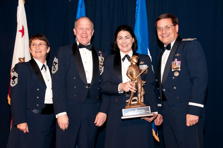 Tech. Sgt. Kristina Ghio (center) from the 162nd Combat Communications Group accepts the Outstanding Airman of the Year award in the NCO category. Accompanied by Chief Master Sgt. Debra Fordyce, (far left) Command Chief Master Sgt. Christopher Muncy, (left) and Brig. Gen. James Witham at the annual Outstanding Airman Of The Year Awards Banquet at The Sheraton Universal Hotel, Universal City, Calif., January 21, 2012. Each organization nominated four candidates for Airman of The Year, NCO of The Year, Sr. NCO of The Year and First Sergeant of The Year. U.S. Air Force photo by Tech. Sgt. Alex Koenig