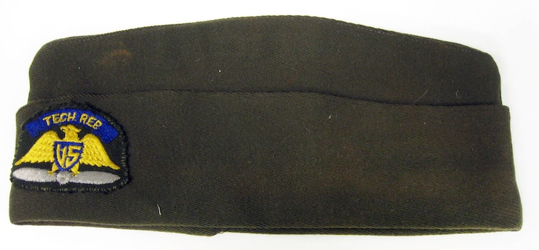 This garrison cap belonged to the donor's father, Wentworth D. Fling, who served as a civilian technology representative working for Fairchild Camera and Instrument Co. in early 1944, developing and training B-24 gunners in the use of the Fairchild K-8 electronic gunsight. (U.S. Air Force photo)