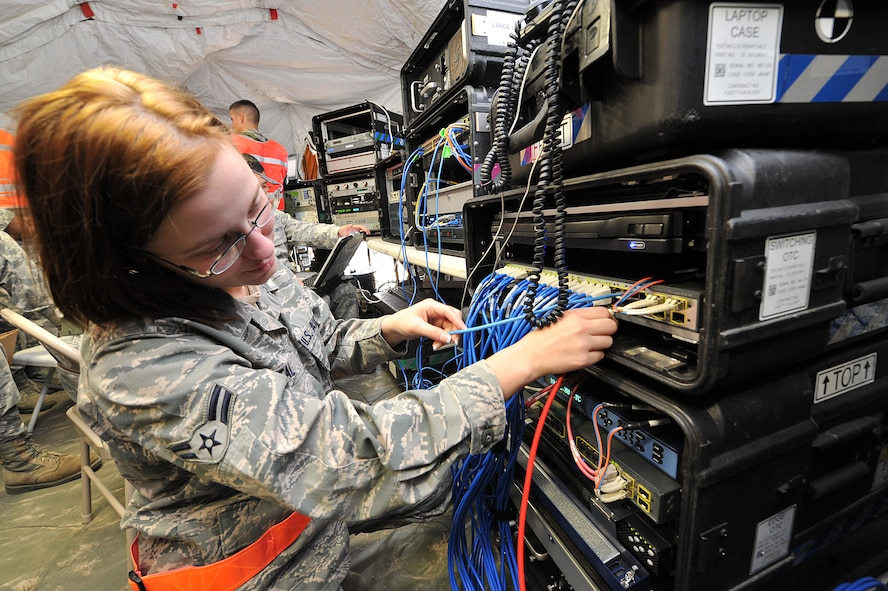 SAVANNAH AIR NATIONAL GUARD BASE, Ga. – Airman 1st Class Khrysta Neal, a 52nd Combat Communications Squadron cyber surety apprentice, installs a cable on the a router that is part of the initial communications element system, designed to deliver NIPRNET, SIPRNET, and secure/non-secure voice communications to bare-base deployed locations, here Jan. 24. The unit began its Arctic Gator field training exercise Jan. 24 and will build, operate in and defend a fully functioning bare base communications camp before the exercise ends Feb. 3. (U.S. Air Force photo by Tommie Horton)