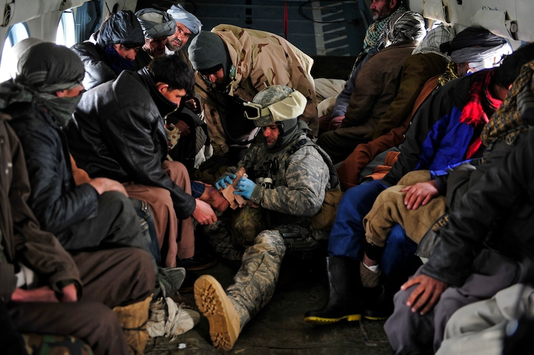 Master Sgt. Chris Banks, a medic with the 438th Air Expeditionary Advisory Group, attends to injured village members on an Mi-17 helicopter Jan 24, 2012. American and Afghan Airmen conducted a rescue mission in Badakshan province; Afghanistan after an avalanche trapped and injured members of Shewa Village. (U.S. Air Force photo/ Master Sgt. Shane A. Cuomo)