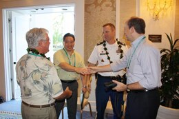 "HAWAII — Lt. Col. Douglas B. Guttormsen, U.S. Army Corps of Engineers Honolulu district commander (second from right), recently attended the Association of Pacific Ports (APP) winter conference at Ko'olina on Oahu and presented a briefing called, the ""U.S. Army Corps of Engineers: Your Partner in the Pacific."""