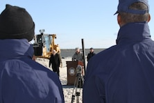 Lt. Col. Philip M. Secrist, U.S. Army Corps of Engineers Philadelphia district commander, speaks about the beach nourishment project as two U.S. Coastguardsmen look on. The $9 million project placed about 600,000 cubic yards of sand onto the beach.