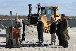 Lt. Col. Philip Secrist, U.S. Army Corps of Engineers Philadelphia district commander, speaks about the Cape May beach nourishment project along with representatives from Cape May, New Jersey Department of Environment Protection, the U.S. Coast Guard, and Congressional staff for Congressman Frank LoBiondo and Senator Frank R. Lautenberg. The $9 million project placed approximately 600,000 cubic yards of sand onto the beach and was cost shared by USACE, the Coast Guard, NJDEP and Cape May City.